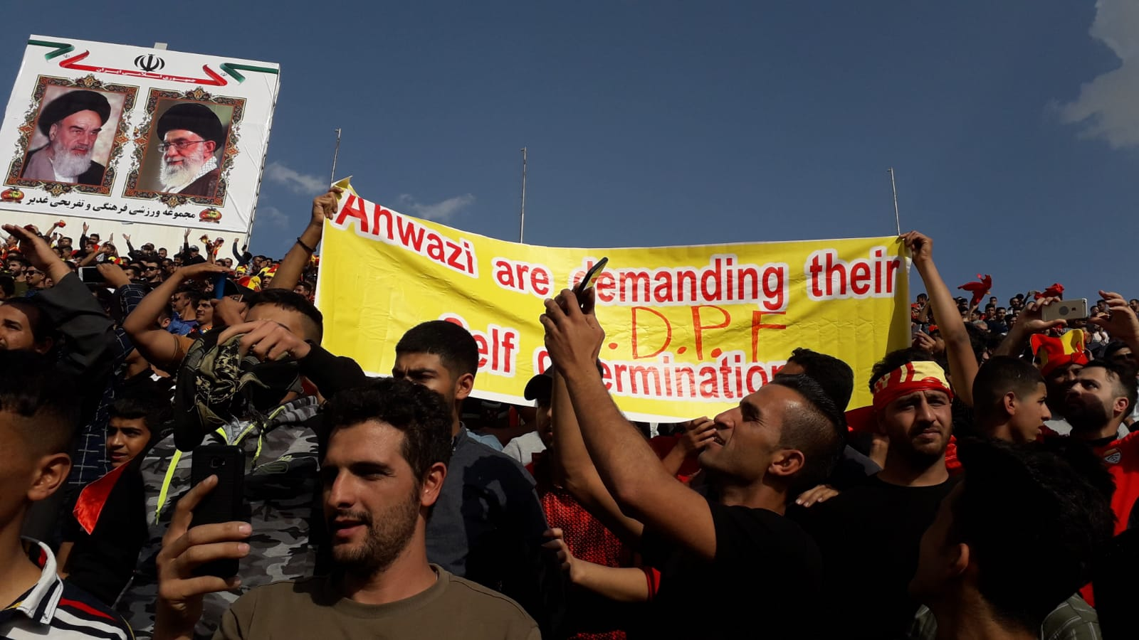 Photo of A Banner Held Up by Ahwazi Activists; Ahwazis are Demanding their Self-Determination.